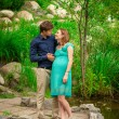 Young pregnant woman with young man outdoor — Stock Photo