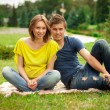 Young beautiful pregnant woman with young man — Stock Photo