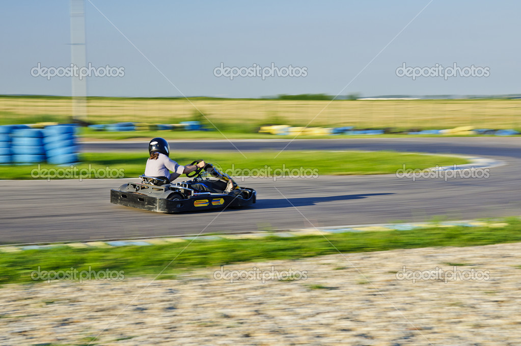 Karting racer trying to beat other competitors — Stock Photo #11407788