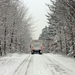 Stock Photo: Truck driving in the snow in the countryside from the Netherland