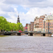 City scenic from Amsterdam with the Munt tower in the Netherland - Stock Photo
