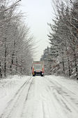 Truck driving in the snow in the countryside from the Netherland — Stock Photo