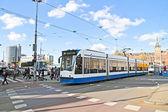 Trams at Central Station in Amsterdam the Netherlands — Stok fotoğraf