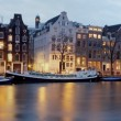 Panoramic view from Amsterdam in the Netherlands at twilight - Stock Photo