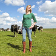 Stock Photo: Peasant womand her cows