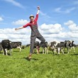 Happy dutch farmer with his cows in countryside — Stock Photo #11248414