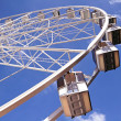 Stock Photo: Ferris wheel against a blue sky