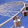 Ferris wheel against a blue sky — Stock Photo