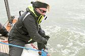 Sailor at work during sailing race — Stock Photo