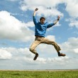 Happy guy jumping in the air — Stock Photo