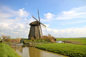 Traditional windmill in dutch landscape — Stock Photo