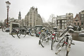 Snowy bikes in the citycenter, Amsterdam — Stock Photo