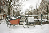 Bikes in the snow in Amsterdam the Netherlands — Stock Photo