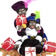 Two black Piet with a bag full of gingernuts and candies — Stock Photo #11305767