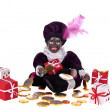 Zwarte Piet with presents and sweets for typical dutch festivity at 5th of december — Stock Photo #11306792