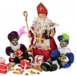Traditional dutch culture:Santa Claus and black Piet with gingernuts, candies and presents at 5th december — Stock Photo