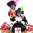 Zwarte Piet with presents and sweets for typical dutch festivity at 5th of december — Stock Photo #11306866