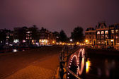 Amsterdam inner city by night in the Netherlands — Stock Photo