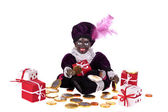 Zwarte Piet with presents and sweets for typical dutch festivity at 5th of december — Stock Photo