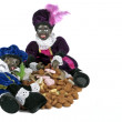 Traditional dutch culture: Two black Piet with a bag full of gingernuts and candies at 5th december — Stock Photo