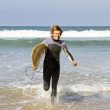 Surfer with his surfboard at the atlantic ocean — Stock Photo