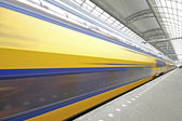 Train departure from Central Station in Amsterdam the Neherlands — Stock Photo