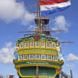 VOC ship in Amsterdam harbor Netherlands with dutch national flag — Stock Photo #11449789
