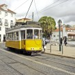 Historical tram driving through Lisbon city in Portugal — Stock Photo #11453967