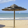 Parasols in summer at the beach — Stock Photo