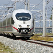 Fast speed train running in the countryside from the Netherlands — Stock Photo
