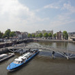 Cruising through Amsterdam on the river Amstel in the Netherlands — Stock Photo
