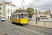 Historical tram driving through Lisbon city in Portugal — Foto Stock