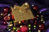 Golden gift and christmas decoration — Stock Photo