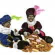 Two black Piet with a bag full of gingernuts and candies at 5th december — Stock Photo