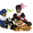 Two black Piet with a bag full of gingernuts and candies at 5th december — Photo #11467810