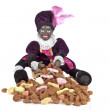 Black Piet sitting on a bag with gingernuts and candies — Stock Photo