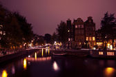 Amsterdam by night with the river Amstel in the Netherlands — Stock Photo