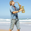 Professional saxophone player at the beach — Stock Photo