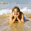 Young guy enjoying in the water from the ocean — Stock Photo