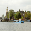 Floating bus is cruising through Amsterdam canals — Stock Photo