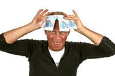 Man with funny face and banknotes covering his head — Stock Photo