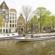 Stock Photo: Cruising through Amsterdam canals