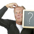 Surprised man with a chalkboard with questionmark — Stock Photo