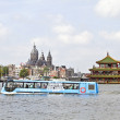 Stock Photo: Floating bus is cruising through Amsterdam canals