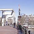 Cityscenic from Amsterdam with the Thiny bridge — Stock Photo