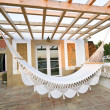 Hammock on terrace of bungalow — Stock Photo #11504518