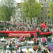Amsterdam boat participates in Canal Parade on Gay Pride weekend - Stock Photo