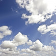 Beautiful cloudshape with sunrays and blue sky — Stock Photo