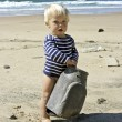 Cute baby boy playing on the beach in summer — Stock Photo