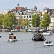 Classical Amsterdam view at the harbor from Amsterdam in the Netherlands — Stock Photo